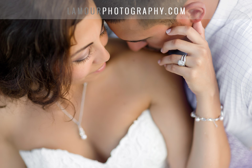Bride and groom in Hawaii on their wedding day with focus on wedding ring