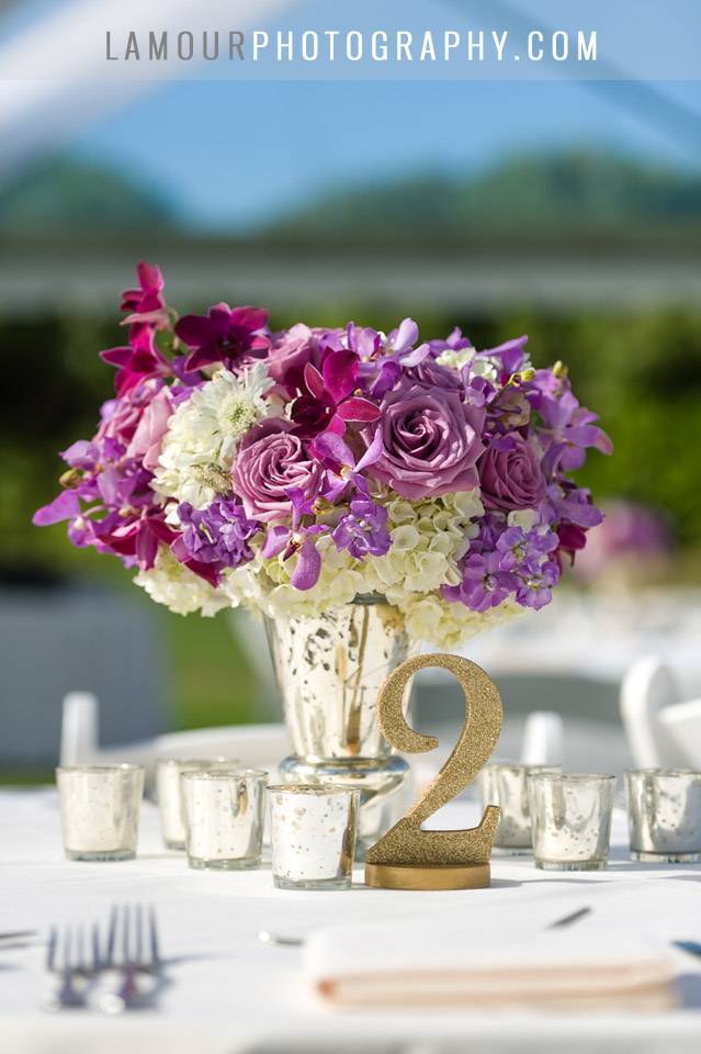 wedding centerpiece of reception at turtle bay wedding in hawaii on island of oahu with purple and cream flowers and gold details