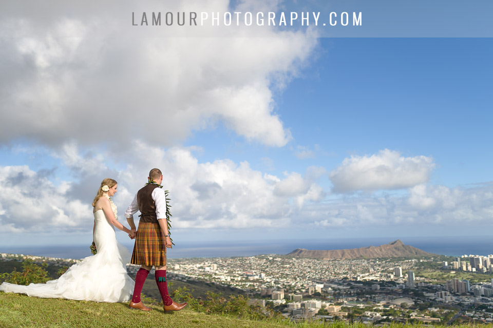 Bride and groom just got married in Hawaii and look out over Oahu after Hawaii wedding