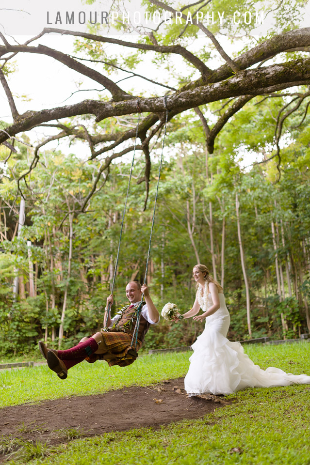 Cute photo of Bride pushing groom on a swing in Hawaii