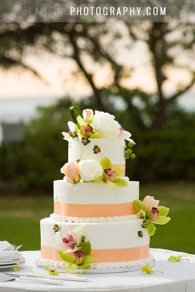3 tier round buttercream wedding cake with orange ribbon