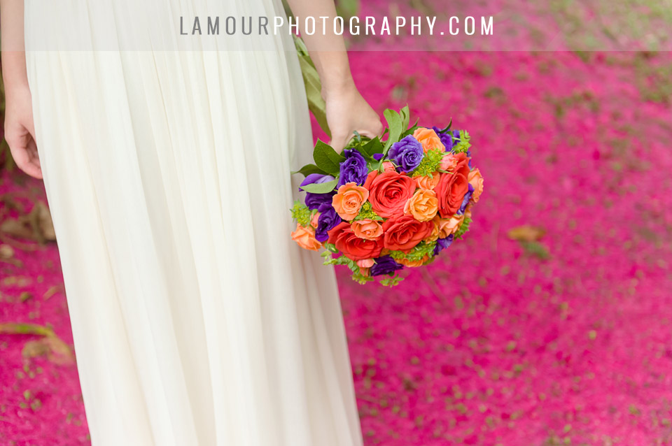 haiku fardens bride holds purple orange wedding bouquet