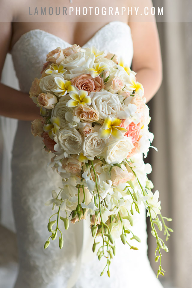 cascading wedding bouquet in hawaii with plumeria orchids and roses