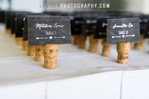 cute place cards settings with hearts arrows and wine cork