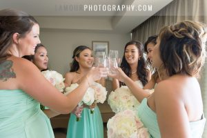 bride toasts champagne in bridal suite at turtle bay