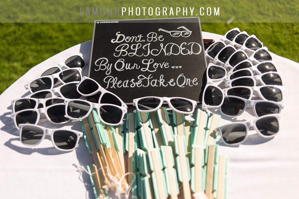 dont be blinded by our love sign with sunglasses at wedding ceremony on oahu
