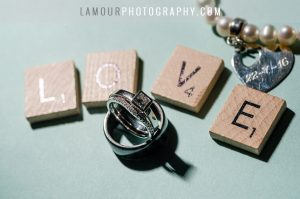scrabble pieces spell love with wedding rings for hawaiian ceremony