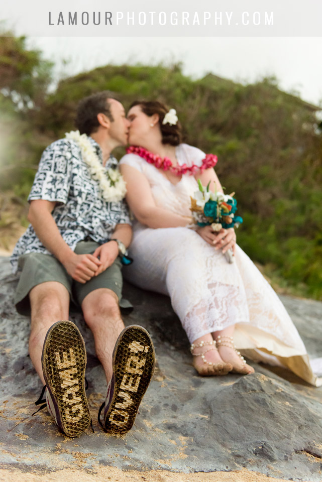 hawaii beach wedding couple in oahu wearing game over sandals