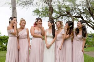 bridesmaids and bride in blush dresses for hawaii wedding