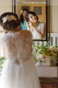 Bride in lace back destination wedding dress in hawaii maui