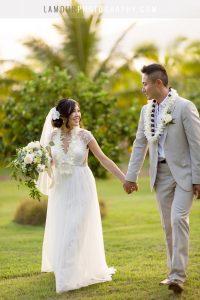Hawaii bride and groom walk in destination wedding in maui