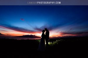 bride and groom in hawaii wedding kiss at sunset in maui