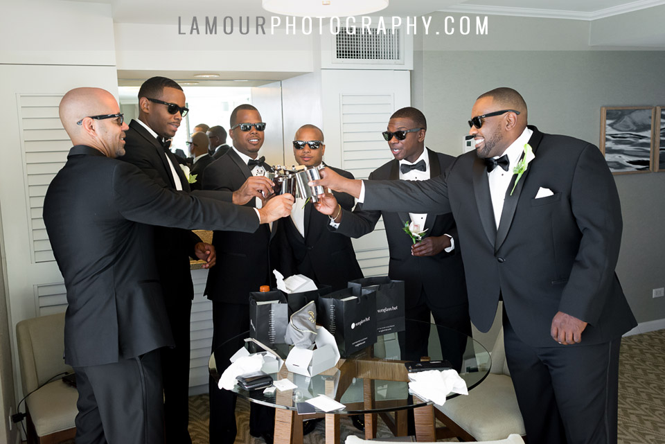 Groomsmen and groom in classic suit and tie and sunglasses in Hawaii