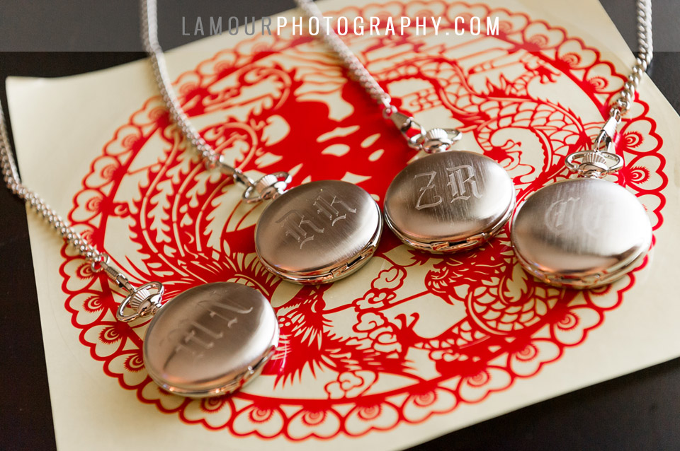 groom of hawaii destination wedding gave silver pocket watched to groomsmen with their initials engraved on the them