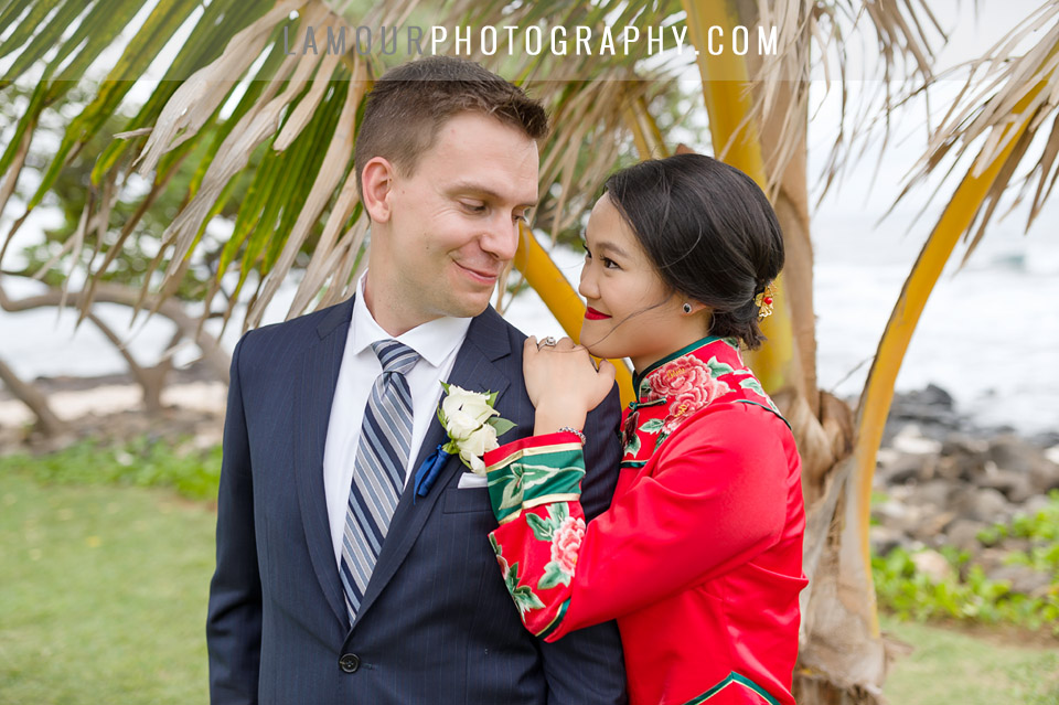 Hawaii wedding by the beach with groom wearing navy blue suit and striped tie