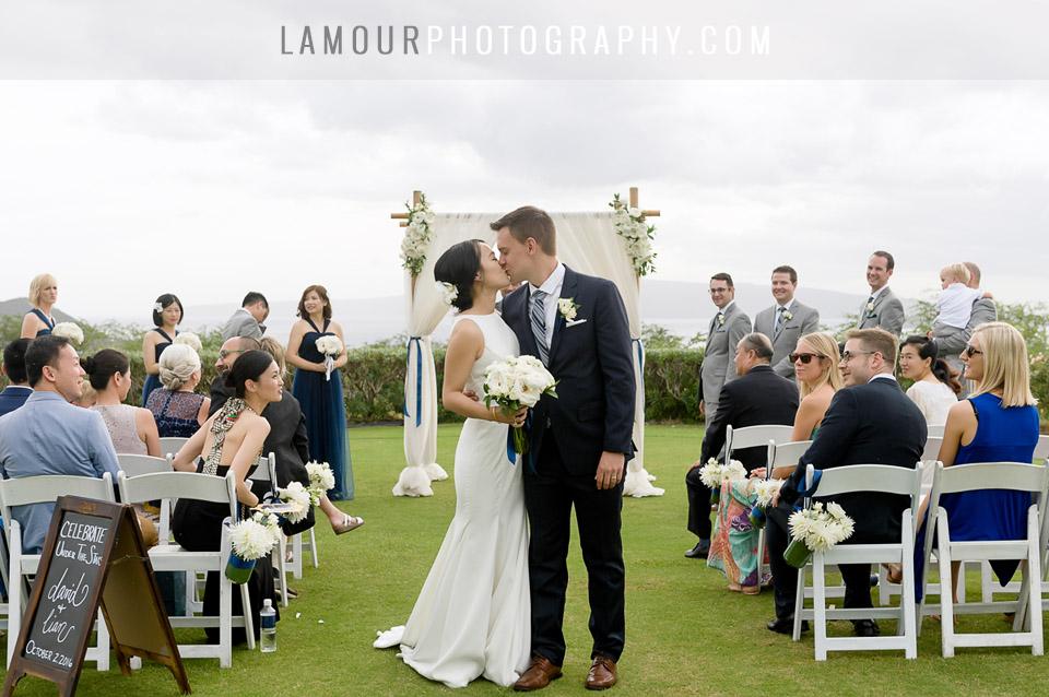 Destination wedding couple shares a kiss after saying I do in Maui Hawaii