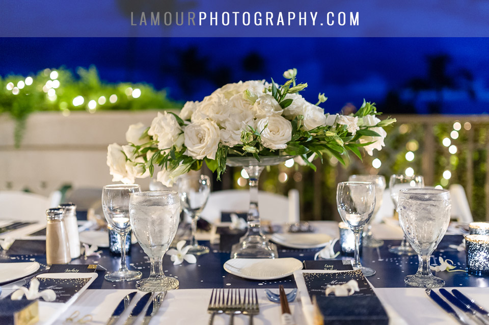 Maui wedding reception for destination bride and groom with color scheme of navy blue, white and gold.