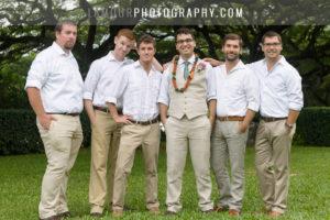 Groom and Groomsmen smile for wedding photos on Oahu