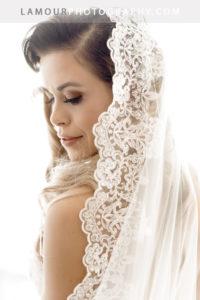 Beautiful destination wedding bride gets ready in her hotel on Waikiki Beach in Honolulu