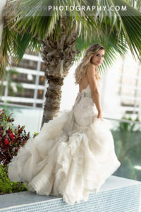 Hawaii wedding photographers from the team at L'amour photograph this gorgeous bride in her flowing destination wedding dress