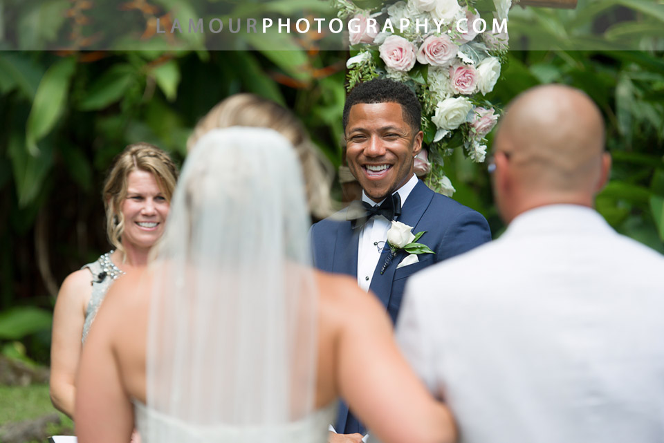 Groom sees bride walking down the aisle at Haiku Gardens wedding on the Hawaii island of Oahu