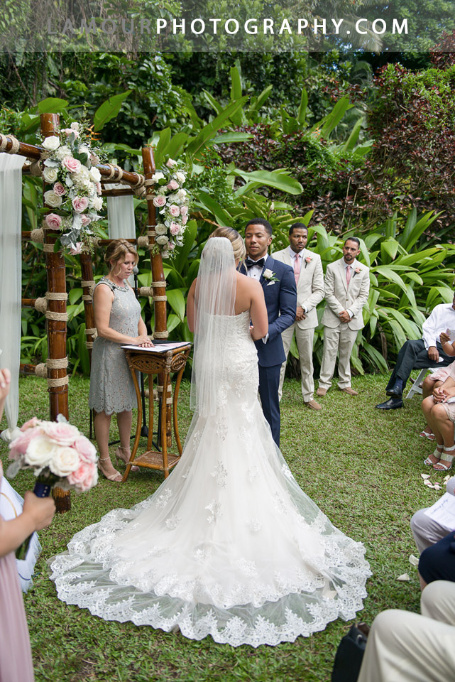 Hawaii destination wedding bride wears lovely lace wedding dress with corset back for wedding on Oahu