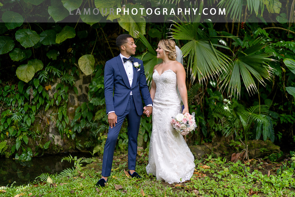 Hawaii wedding photography by Lamour on Oahu with bride and groom among the lush tropical greenery