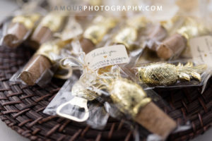 Hawaii wedding reception favors with gold pineapple wine corks