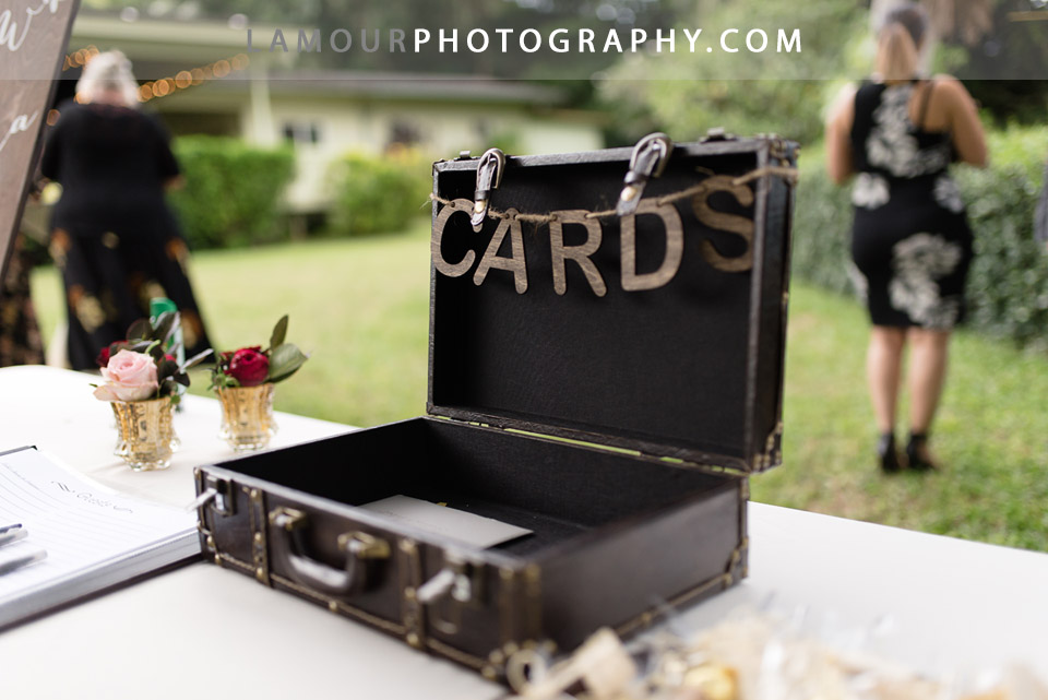 dark brown suitcase serves as cardbox for Kualoa Ranch Wedding reception on Oahu
