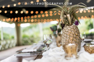 Gold Pineapples were centerpieces for Hawaii wedding reception at Kualoa Ranch