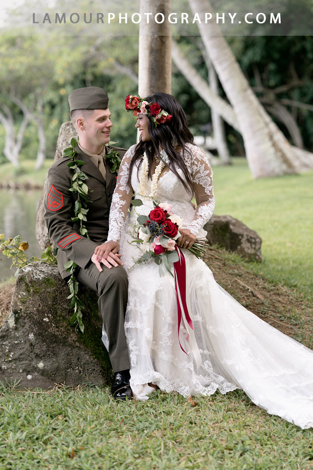 Military wedding in Hawaii withred and gold details at Kualoa Ranch on Oahu