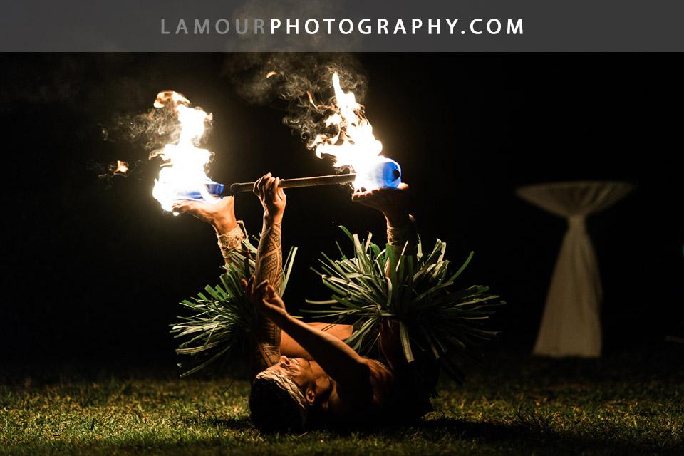 Hawaiian fire dancer performs at a wedding in Hawaii