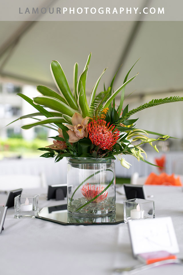 Gorgeous tropical flowers make a stunning wedding reception table centerpiece at Turtle Bay for a Hawaii wedding