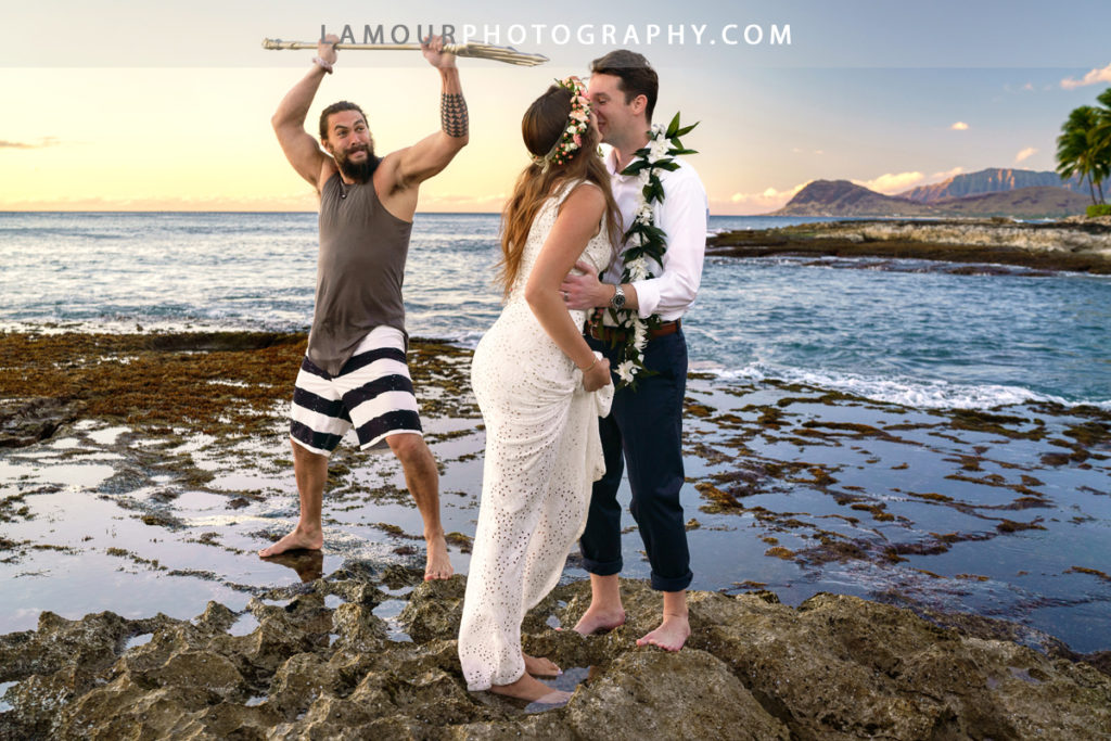 Viral photo of Aquaman Jason Momoa photo bombing Hawaii wedding bride and groom by Lamour wedding photography