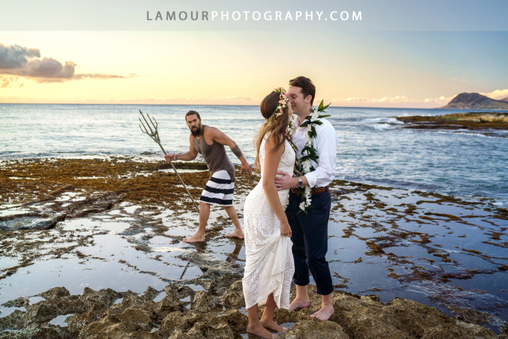 Viral photo of Hawaii wedding couple being photo bombed by Jason Momoa taken by L'amour Photography